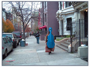 woman carrying cello down West Side Manhattan street